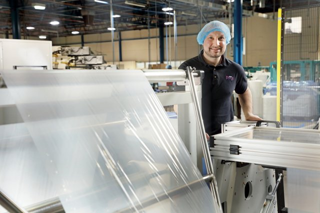 Lee Wilkinson of PFF Group with the new folding machines.JPG