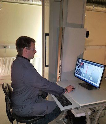 Dr Geraint Havard uses the Zwick 250kN universal testing machine to test carbon fibre..jpg