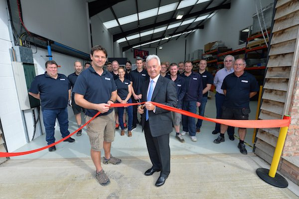 Sir Alan Duncan & Ben Halford cutting the ribbon.JPG
