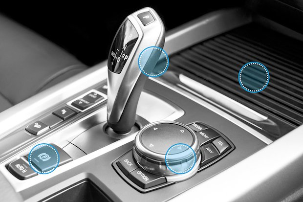 Automatic gear stick of a modern car, car interior details. Black and white