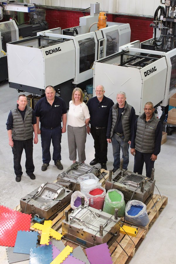 Image 1 Broanmain's Jo Davis with the Faygate team showcase some of their newer machines, larger injection moulding tools and Trudec floor tile samples. .JPG