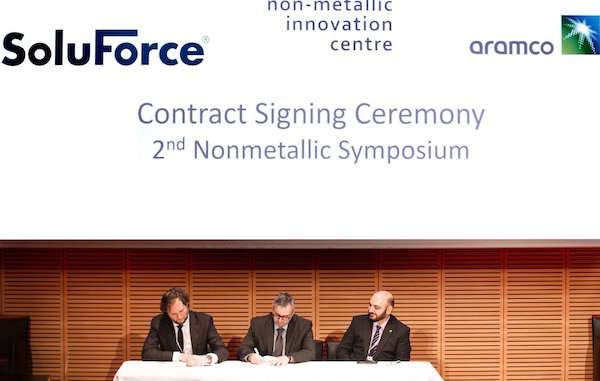 Representatives of NIC and SoluForce sign their Agreement.jpg