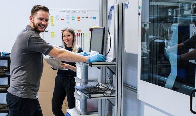 Talisman Plastics' Nathan and Ewelina at a machine cell.jpg
